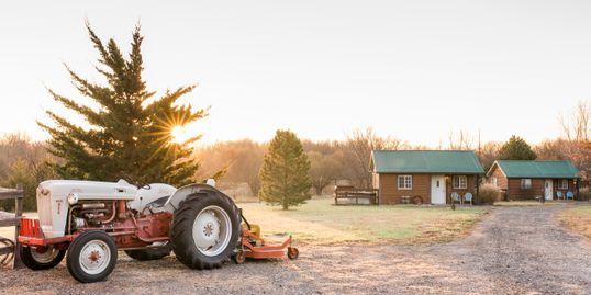 ThePrairieGardensInn-TractorAtSunset